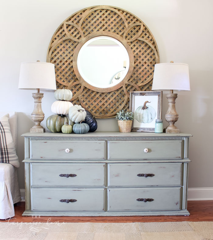 Simple, neutral blues and greens fall entry way ...