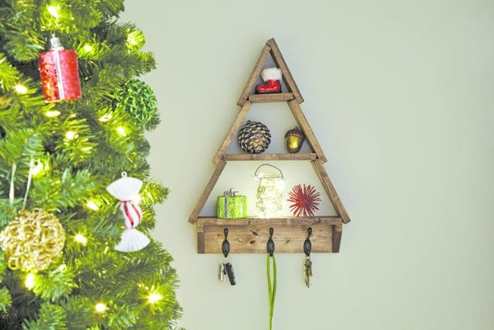 Learn how to make this wonderful Christmas Tree Shelf and put your own spin on this super cute decor. Perfect for the holidays!