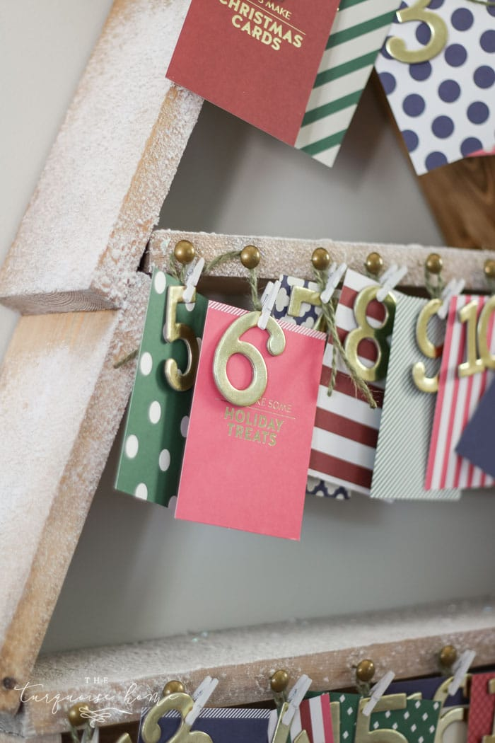 The most adorable DIY snowy Christmas Tree Shelf lends itself to the perfect spot for an advent calendar. LOVE it!!