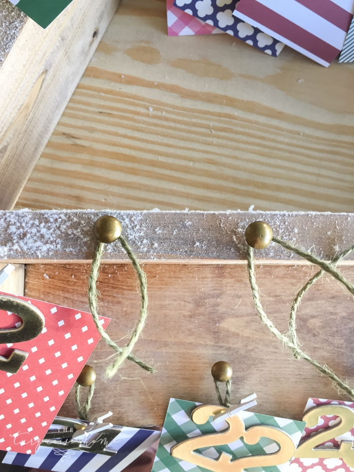 Add brass nail tacks for the Advent Calendar ... The most adorable DIY snowy Christmas Tree Shelf lends itself to the perfect spot for an advent calendar. LOVE it!!