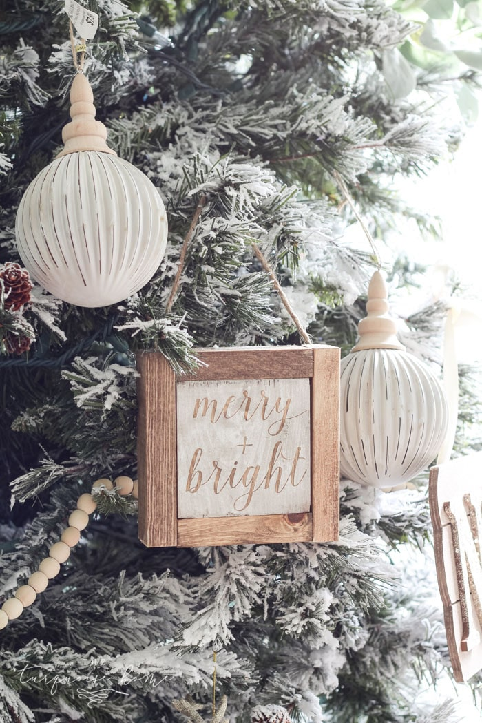Create a simple wooden sign with a cute saying and create a rustic, farmhouse Christmas look for cheap!