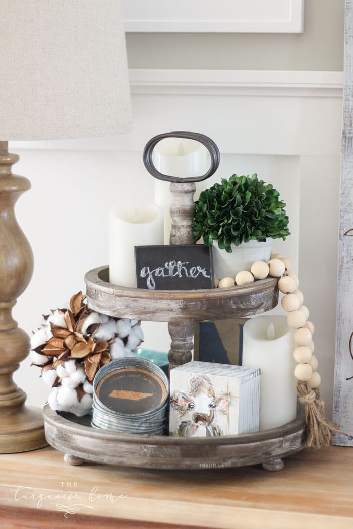 A tiered stand filled with goodies that would make the perfect stocking stuffers for the farmhouse decor lover!