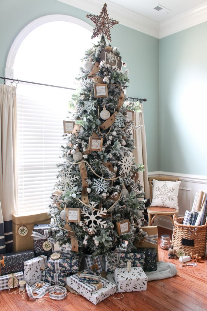 My Flocked Farmhouse Christmas Tree - super cute cotton stems, lamb's ear, galvanized snowflakes, and wooden bead garland.