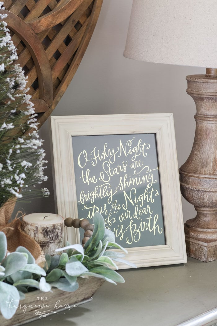 O Holy Night art adds just enough holiday decor to this space! A neutral Christmas entry way - not too fussy or fancy!