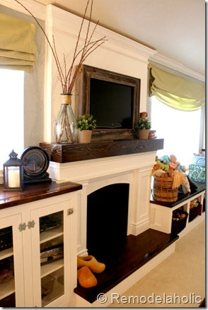 Loved this framed out TV over a mantel. Looks so good!