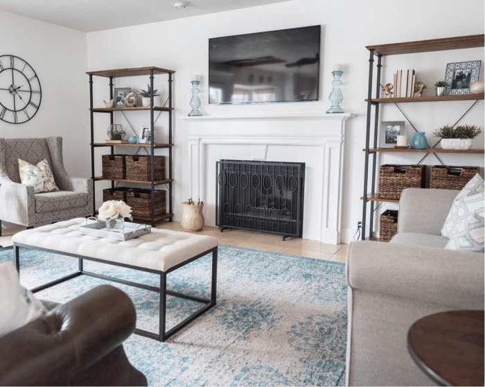 Pretty Mantel flanked with bookshelves and TV