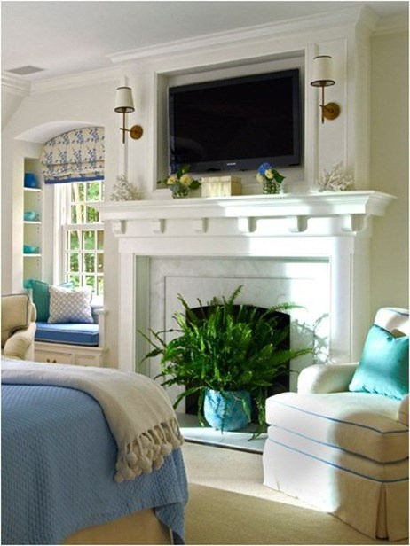 Love the sconces next to the TV! How to decorate around a TV over a mantel.