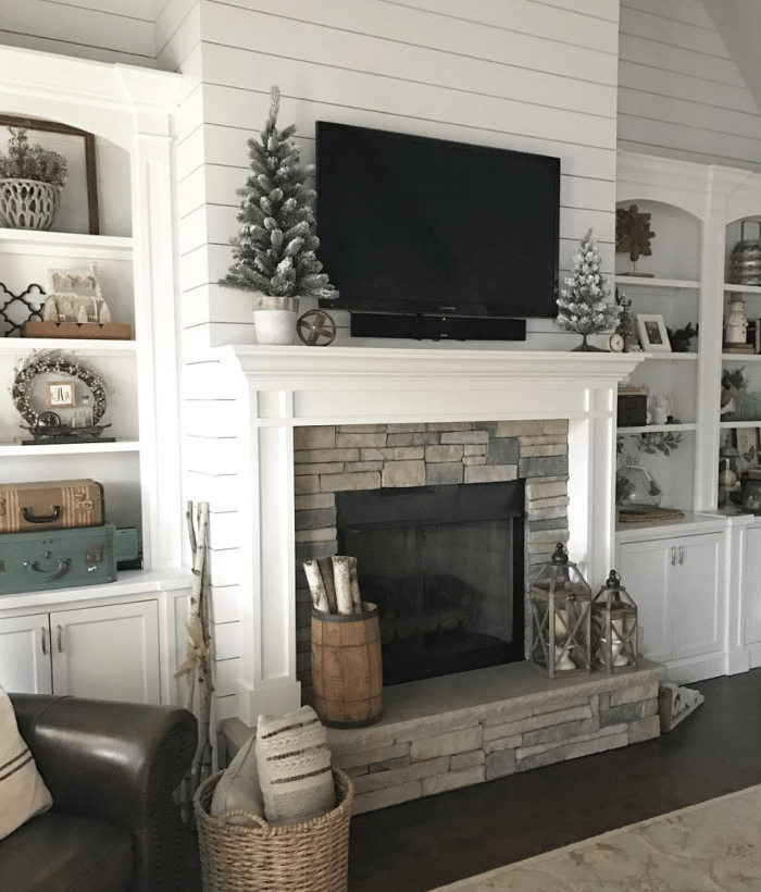 Winter Decorated Mantel With Tv Above It