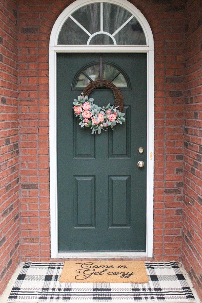 Front door with layered doormats and DIY peonies spring wreath!