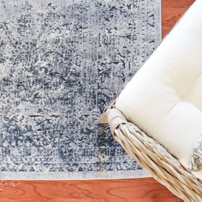 A navy, gray, oatmeal distressed vintage rug. Abbeville Eclectic Dark Gray Area Rug