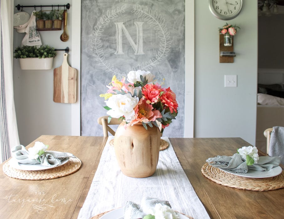 Beautiful teak vase and simple place settings make the perfect addition to the before and after kitchen makeover! | Kitchen Before and After | Kitchen Makeover Ideas | DIY Kitchen Makeover | Kitchen Remodel Before and After