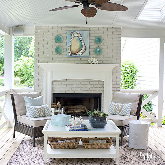 Gorgeous fireplace in an outside seating area. Love these coastal vibes for the front porch!