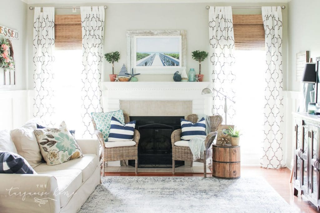 A coastal summer mantel decor ideas. Add a little nautical charm to your living space with these simple coastal summer mantel decor ideas. Featuring DIY beach canvas art, blue & white starfish, textured sailor's knot and cheerfully striped sail boats, this mantel looks great for the seasonally inspired.