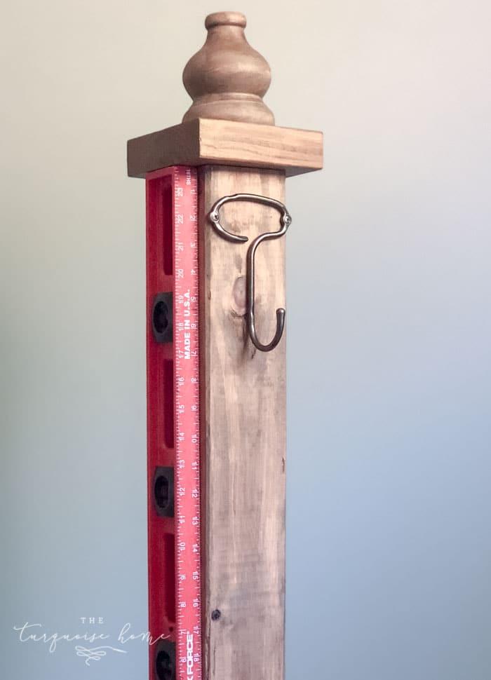 Add decorative hooks to your standing coat rack.   DIY Coat Rack   #buildyourownathome #diyproject #diy #buildlikeagirl