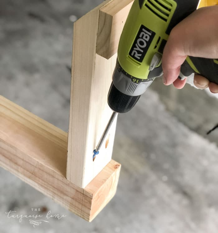 Add the legs to the end of the post with Kreg Jig Screws! #buildyourownathome #diyproject #diy #buildlikeagirl