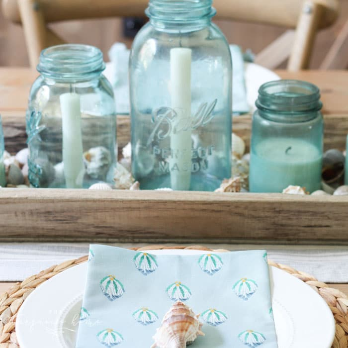 Coastal decor in the dining room with beautiful beachy blues and these coastal napkins from the Opal House line at Target!