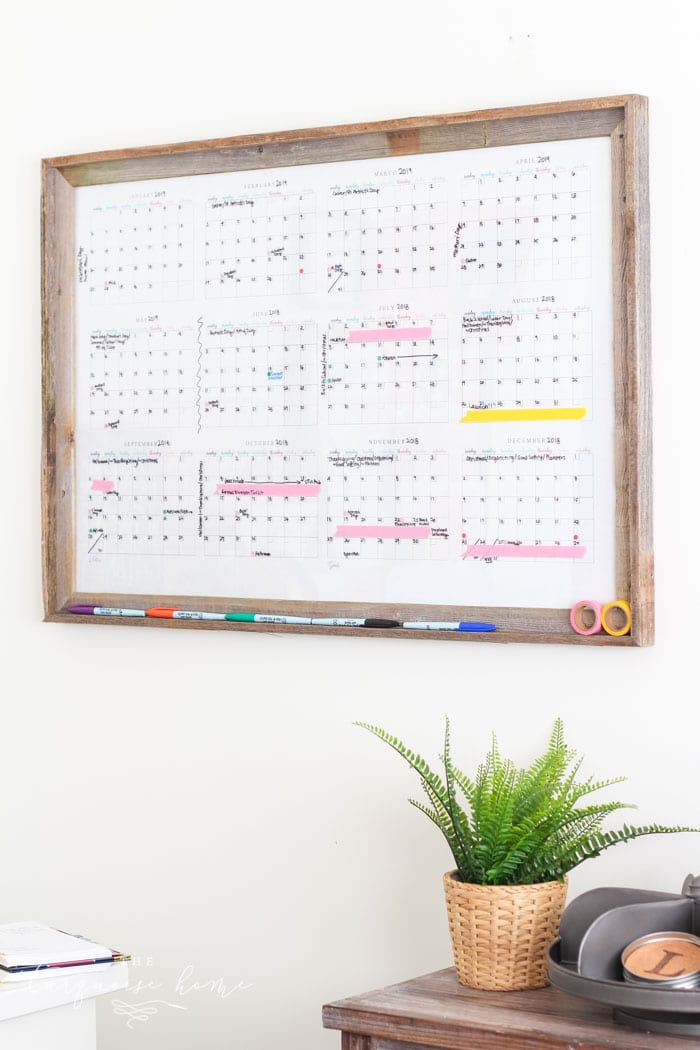 Make your own dry erase calendar board with only 2 steps! Includes a free printable yearly calendar!
