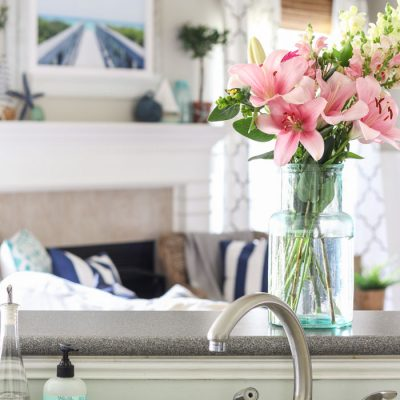 Coastal Summer Home Decor Ideas with fresh flowers and adorable mint Mrs. Meyer's Hand Soap. 😜