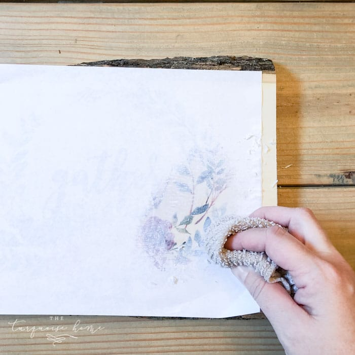 Use a damp cloth or sponge to remove the paper a little bit at a time. DIY Photo Transfer to Wood