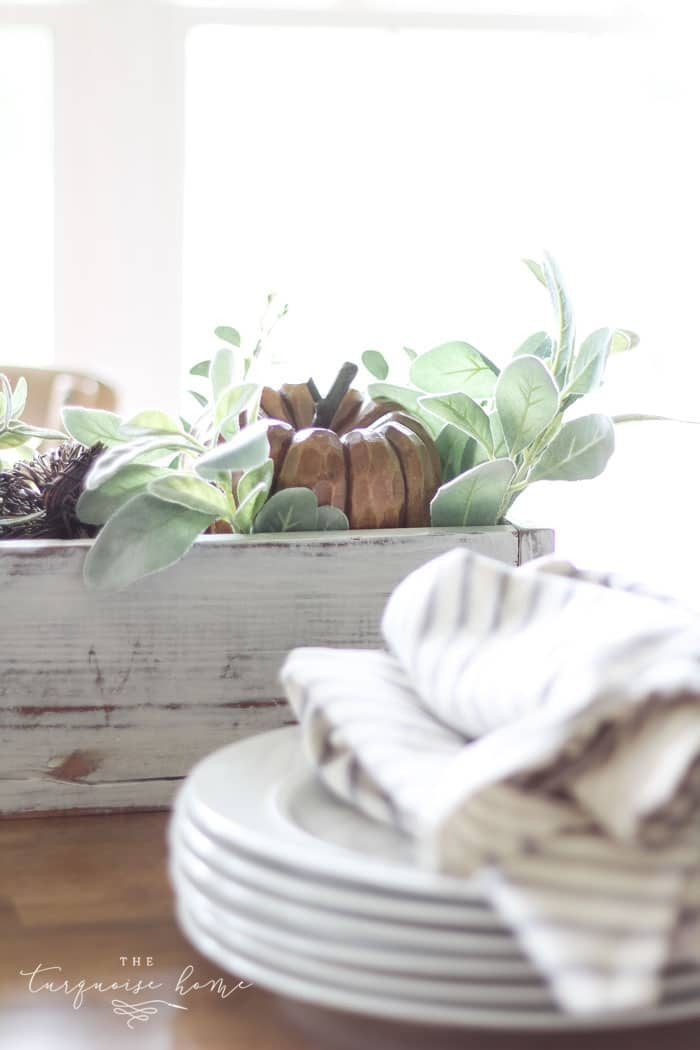 My favorite wooden pumpkin sitting in a bed of lamb's ear leaves. Perfect for a fall centerpiece!