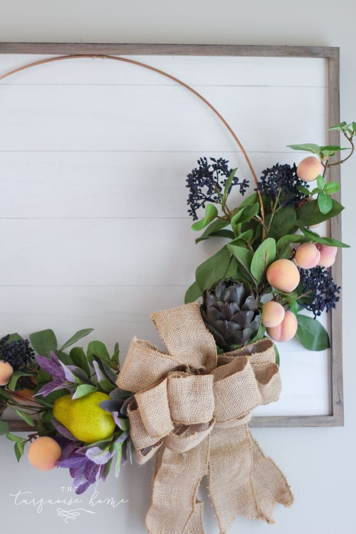 "Hang the gorgeous fall fruit wreath on the framed ""shiplap"" board!"