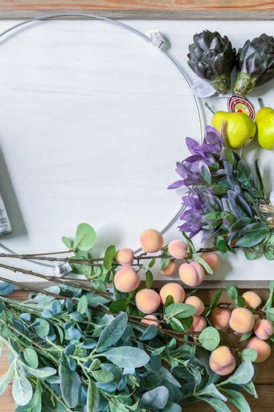 Gather the supplies for your fall wreath with faux fruit!