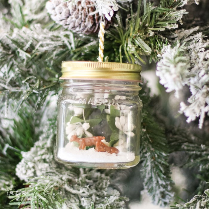 DIY Mason Jar Snow Globe Ornaments with mini deer and winter wreath