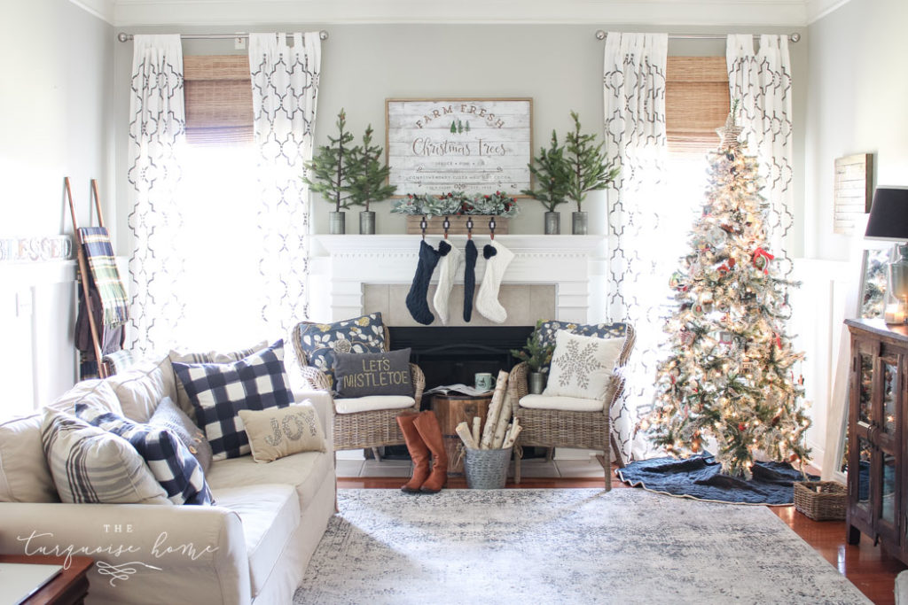 Farmhouse-style living room with flocked Christmas tree.