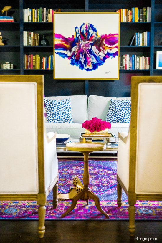 Art layered on a bookshelf - How to Decorate a Bookshelf