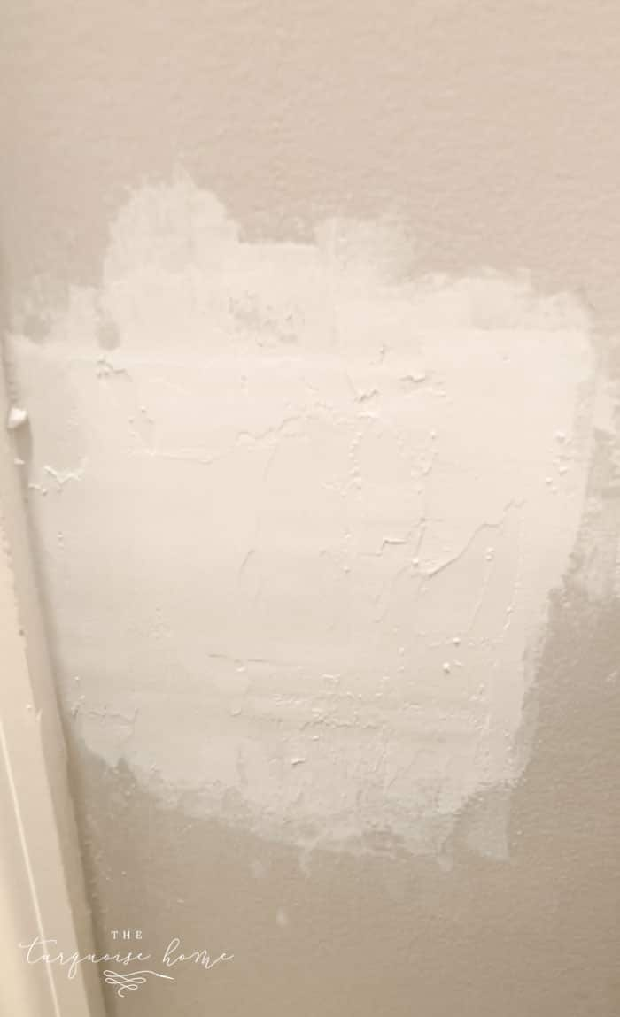How to Patch a Hole in Drywall | Sand down compound until smooth
