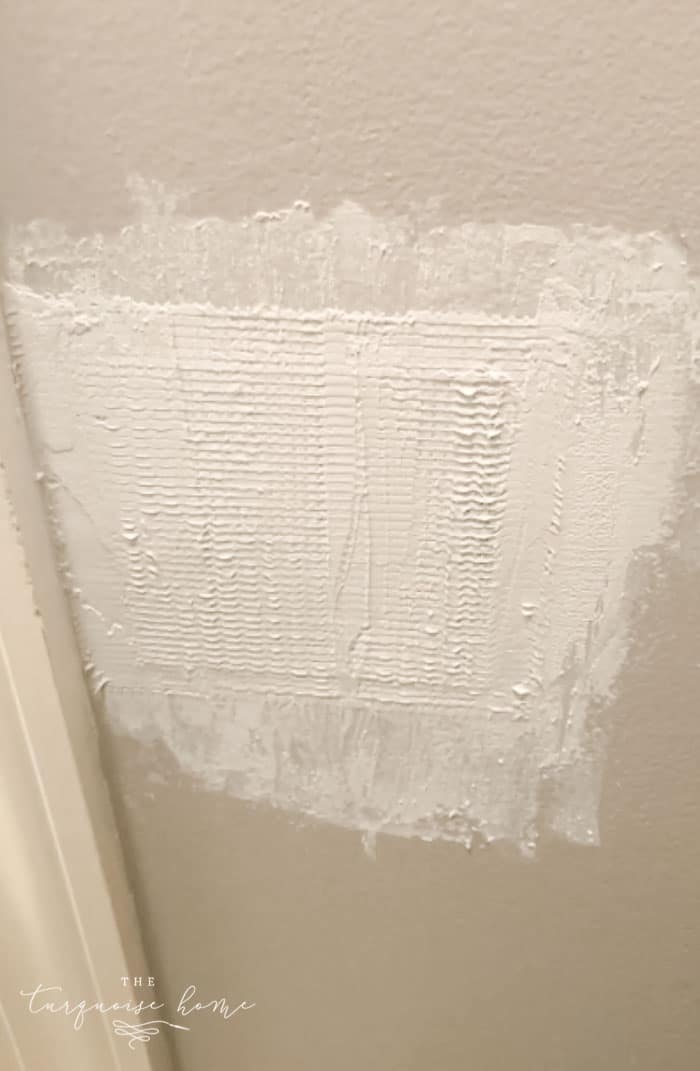How to Patch a Hole in Drywall | Apply a thin layer of spackling compound and let it dry