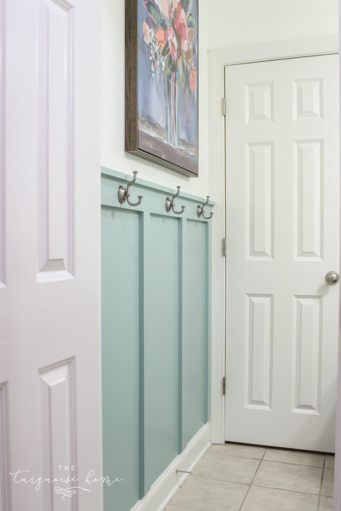 DIY Board and Batten Treatment in the bathroom with hooks | Wythe Blue by Benjamin Moore