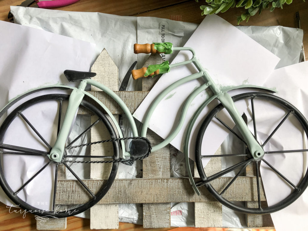 DIY Boxwood and Bicycle Spring Wreath - use paper to protect your fence while painting the bike