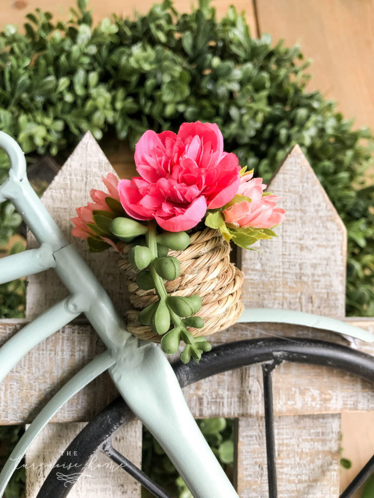 DIY Boxwood and Bicycle Spring Wreath - adding flowers to the basket