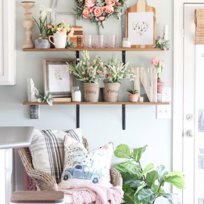 Gorgeous florals on open kitchen shelves... love this look for spring!