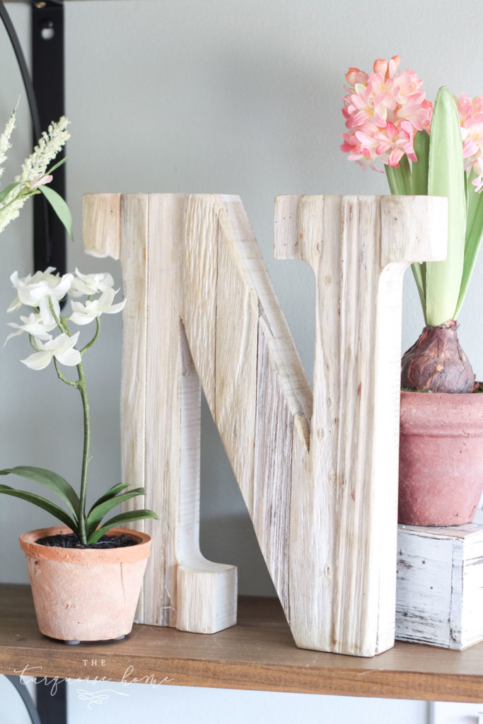 Faux orchids and other flowers make for gorgeous spring decor!