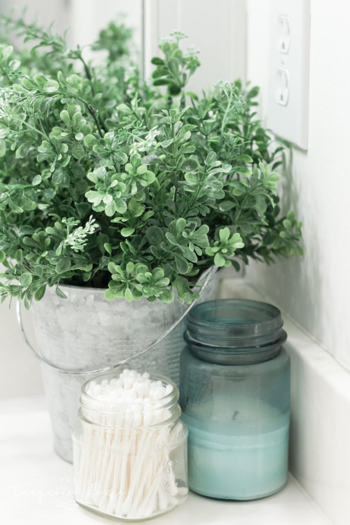 How to Create Big Style in a Small Bathroom | The Girls' Bathroom Refresh Reveal | Boxwood in a Galvanized Bucket | Antique Candles