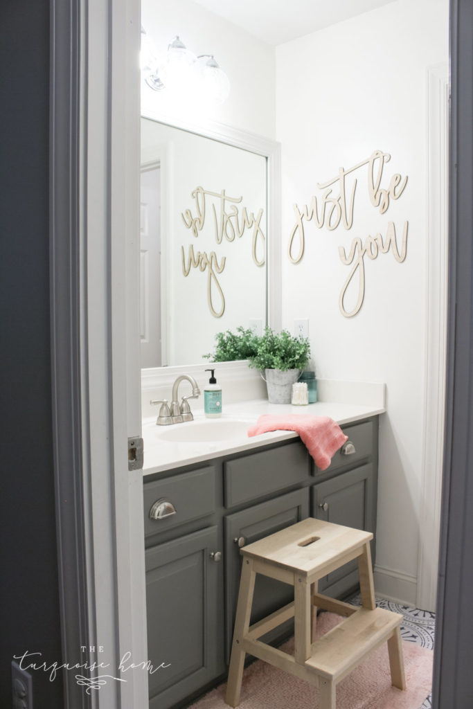 How to Create Big Style in a Small Bathroom | The Girls' Bathroom Refresh Reveal | Wooden Step Stool | Pink Towels | Gray painted cabinets