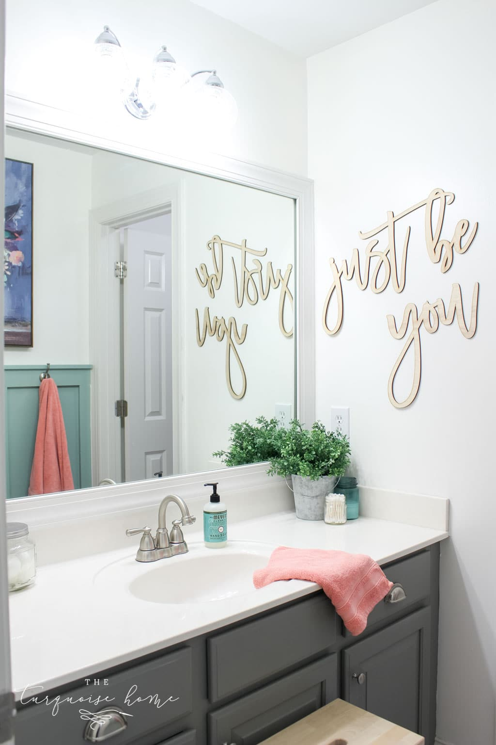 Window arch above the toilet in the girls' bathroom refresh | Use a basket for toilet paper storage and a over-the-toilet cabinet if needed | bathroom makeover