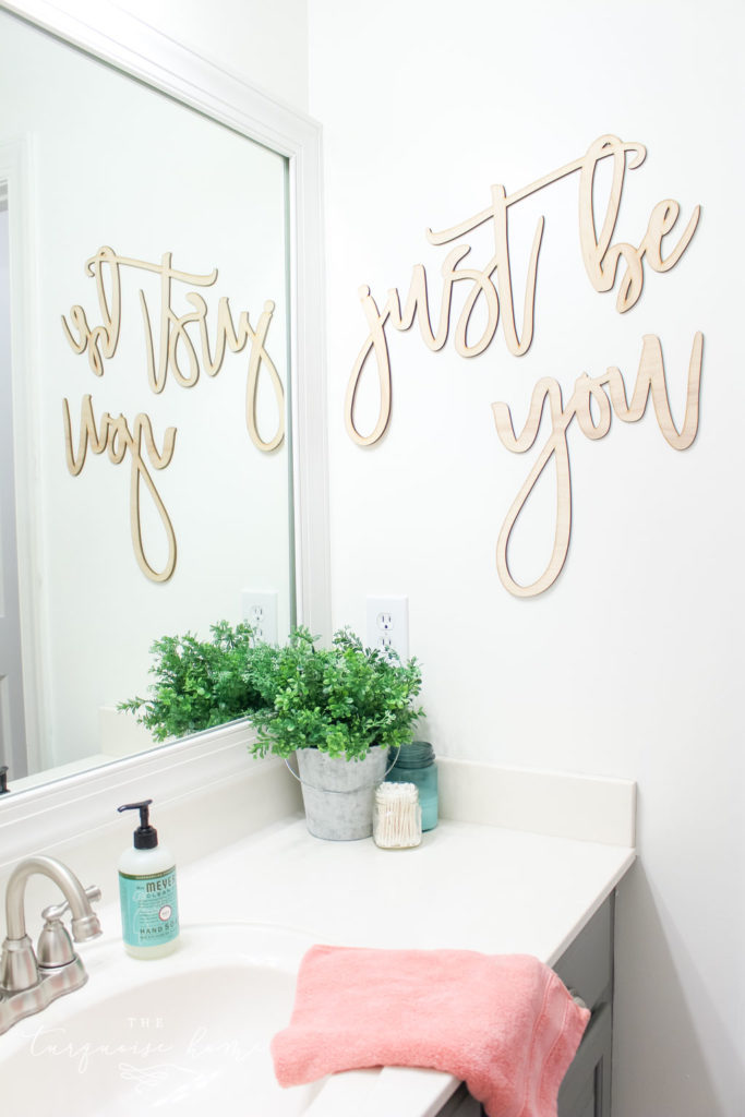 """Just Be You"" wooden script sign in the girls' bathroom makeover"