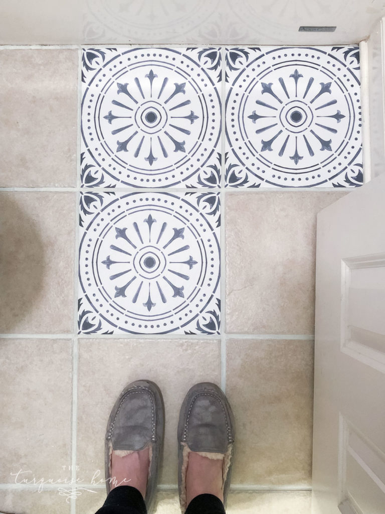 DIY Peel and Stick Vinyl Tile Flooring --> upgrade your old tile floor for little money!