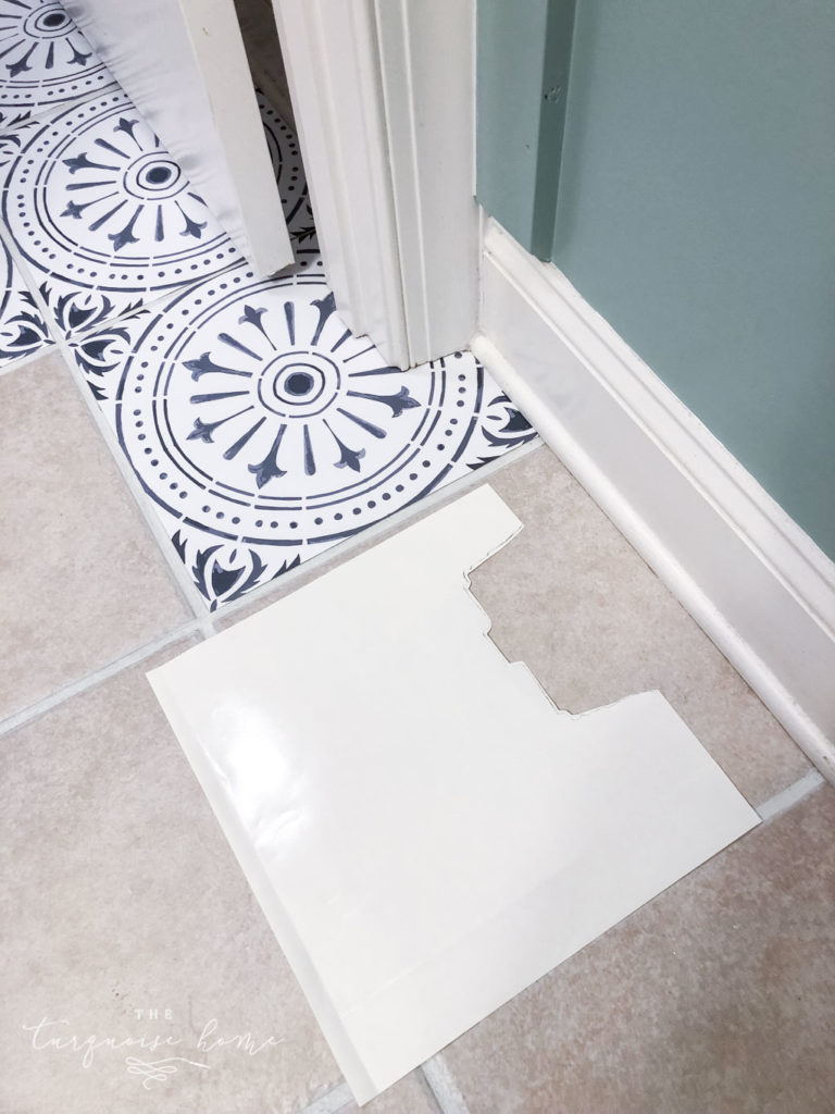 DIY Peel and Stick Vinyl Tile Flooring --> use an old backing to trace the odd angles