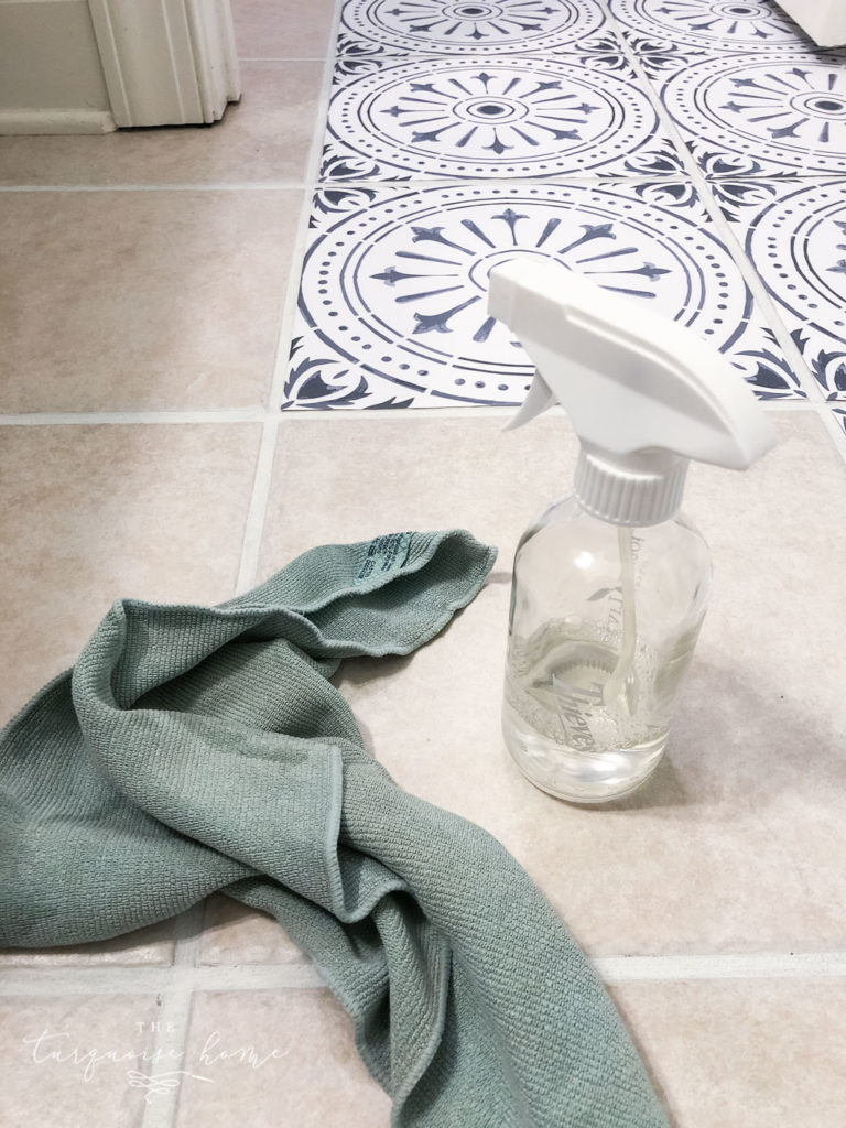 DIY Peel and Stick Vinyl Tile Flooring --> clean the tiles thoroughly before starting!