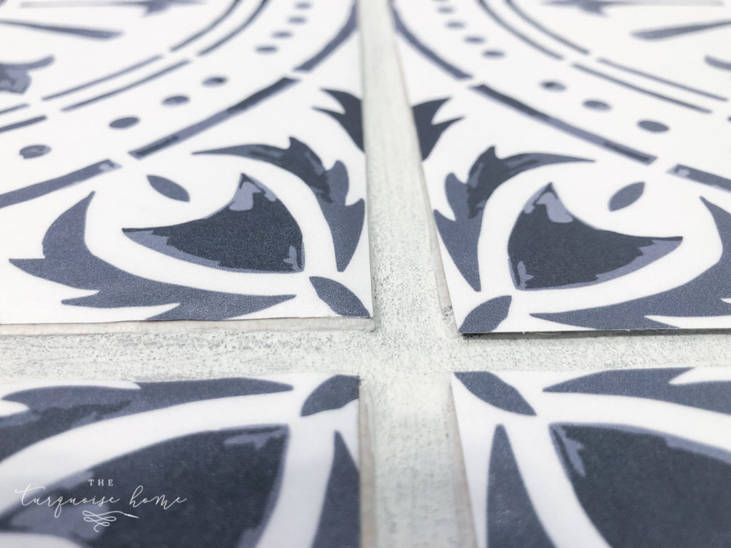 DIY Peel and Stick Vinyl Tile Flooring --> on the right they are regular sized and the left ones are trimmed