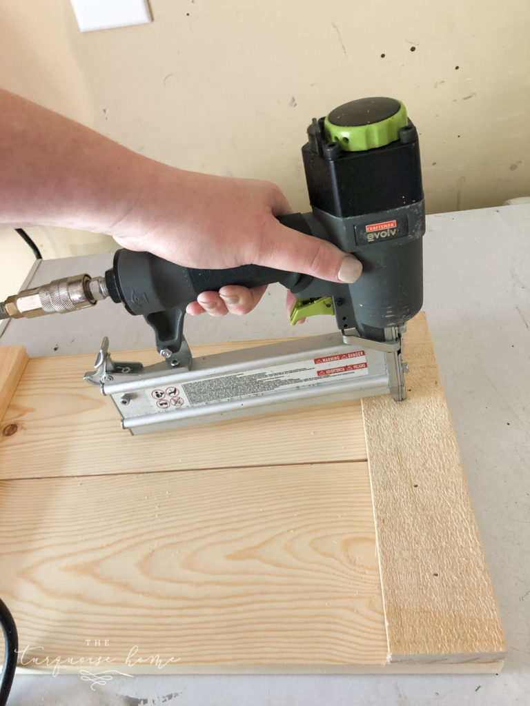 """DIY Wood Planter -->> Add the 11"""" boards to the top of 2 side panels and nail them in with the brad nailer"""