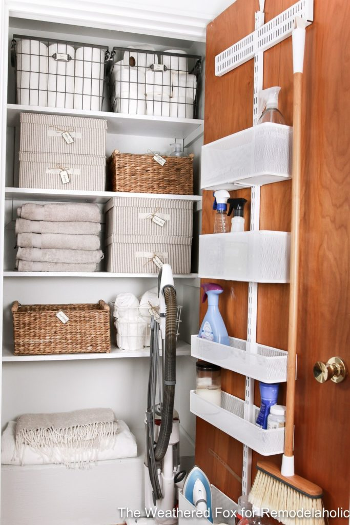 Last, but certainly not least is this beautiful linen closet from the blog Remodelaholic is filled with bins and boxes neatly labeled which I love. Plus, I really want to order a back of the door organizer with adjustable shelves like this one now!