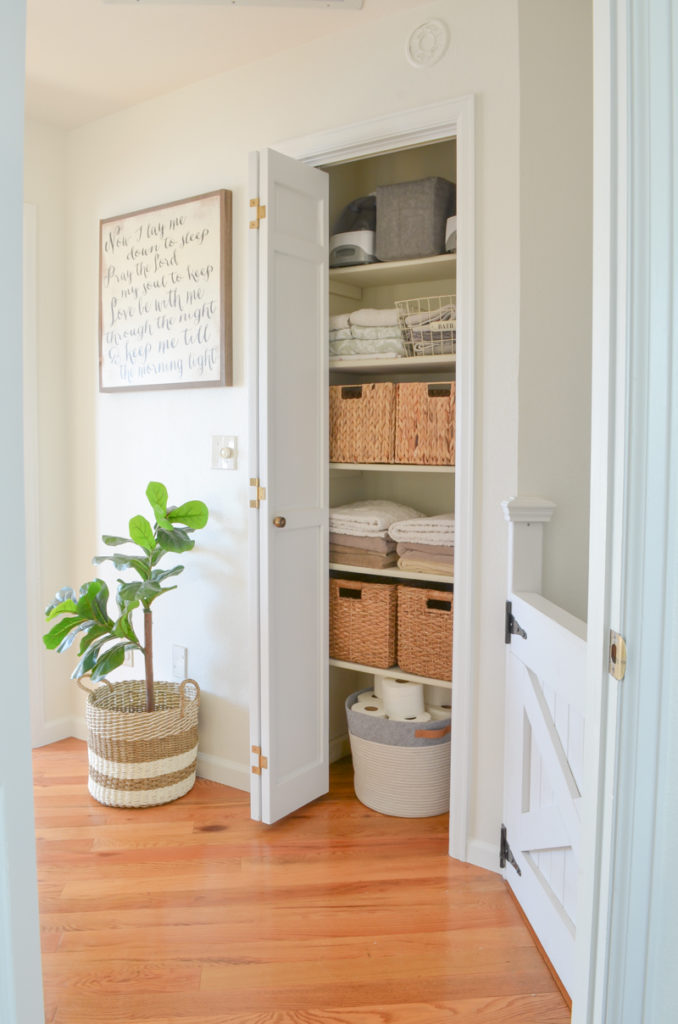 This gorgeous linen closet from Sarah Joy Blog is the perfect combination of storage bins and folded towels with a beautiful bin for corralling toilet paper.