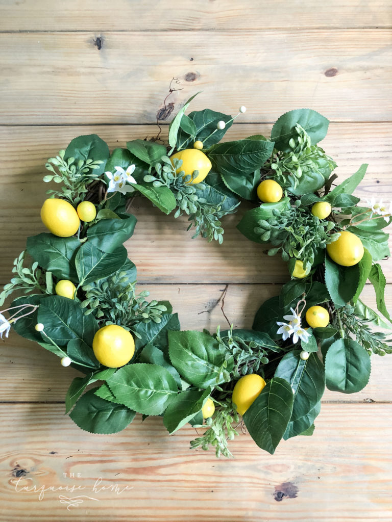 DIY Summer Lemon Wreath: next add in the lemons and other faux-tanicals