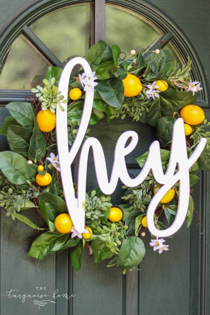 "DIY Summer Lemon Wreath with ""hey"" script hanger - the perfect sentiment for summer!"