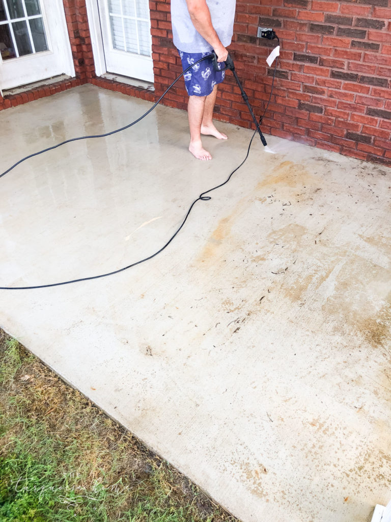 How to Paint a Concrete Patio - pressure wash the patio